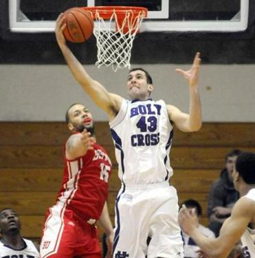 Holy Cross' Taylor Abt grabbed a rebound in front of Boston University's Dom Morris.
