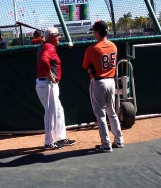 Carl Yastrzemski, left, chatted with his grandson, Mike, before Sunday's game.