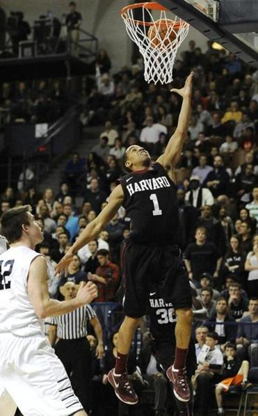 Siyani Chambers drives to the basket for 2 of his 17 points, helping Harvard to its fourth straight Ivy League title.