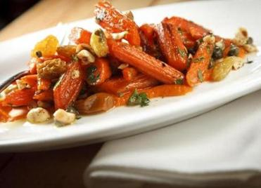 Roast carrots with hazelnuts, raisins, capers, and parsley.