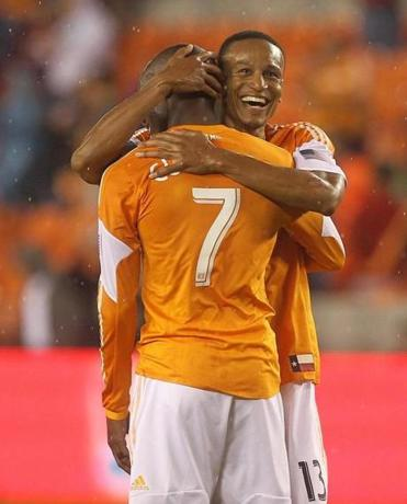 Ricardo Clark and Omar Cummings (7) teamed up after Cummings's goal gave the Dynamo a commanding 4-0 lead.