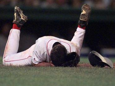 Boston Red Sox's Bryce Florie lies on the ground after being hit in the face by a New York Yankees Ryan Thompson line drive in the ninth inning at Fenway Park, in Boston, Friday, Sept. 8, 2000. Florie was taken off the field. The Yankees beat the Red Sox 4-0. (AP Photo/William B. Plowman) - Library Tag 11042000 National-Foreign