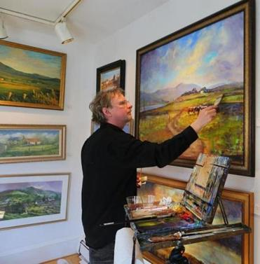 Irish cork painter Vincent Crotty at work at Aisling Gallery in Hingham.
