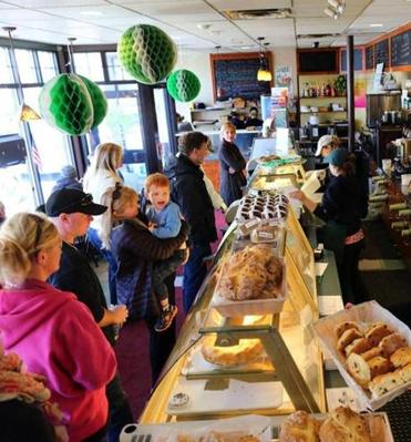 Customers line up for soda bread and other treats at Greenhills Irish Bakery in Dorchester on a recent Saturday morning.