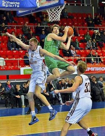 Jake O'Brien grabs a rebound for his Ukraine Superleague team. He cut short his rookie season in the league when violence escalated in the country.