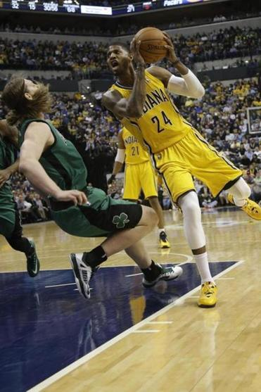 Kelly Olynyk hit the floor after the Pacers' Paul George drove to the basket.