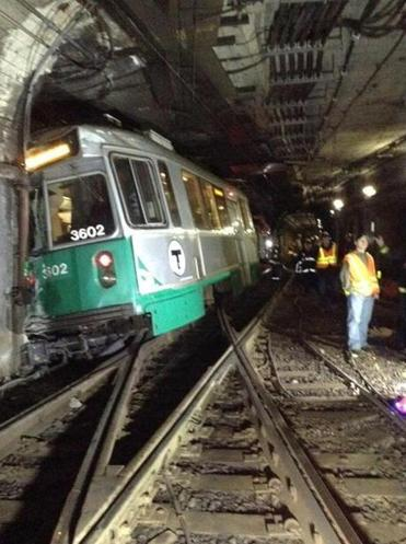 An MBTA Green Line trolley derailed and struck a wall near Kenmore Station on Monday.