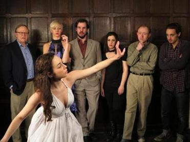 "Alana Osborn-Lief and (behind, from left) Jack Schultz, Jeanine Frost, Kevin Cirone, Emily Hecht, Brooks Reeves, and Diego Buscaglia in Apollinaire Theatre's contemporary take on the play, ""Stupid [Expletive] Bird."""