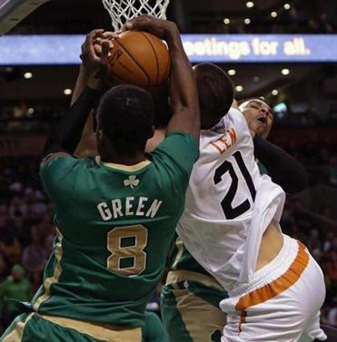 Jeff Green and Jared Sullinger battled Phoenix center Alex Len in Friday's loss.