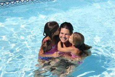 Melanie Feehan enjoyed time last summer in the family's pool in Plymouth, with daughters Shannon (left), 11, and Leela, 10.