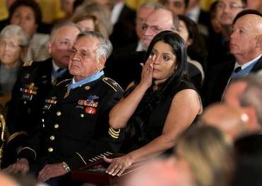Lenora Alvarado, seated next to Rodela, wiped away tears after accepting the Medal of Honor on behalf of her father, Vietnam veteran Specialist Four Leonard L. Alvarado.