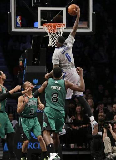 Andray Blatche scored over the Celtics in the first half.