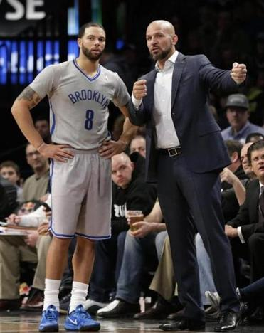 From one point guard to another, Nets coach Jason Kidd gives directions to Deron Williams during Friday's win over the Celtics. Brooklyn improved to 26-10 since Jan. 1.