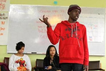 Hakeem Foreman, an organizer with the Dorchester Bay Youth Force, spoke about job-seeking strategies in Somerville.