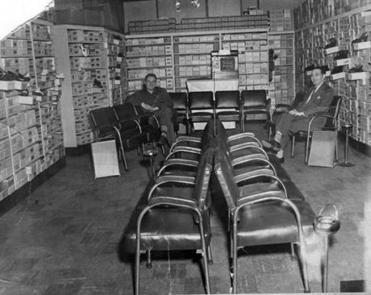 Wein (left) sat and chatted with sales clerk Emil Baye at the store back in the late 1940s