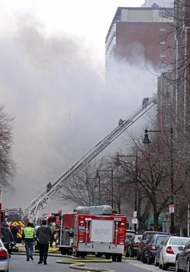 Firefighters at the scene of  the March 26 Back Bay fire.