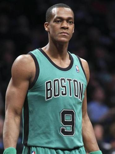 Boston Celtics guard Rajon Rondo (9) waits for play to resume during the first half of an NBA basketball game against the Brooklyn Nets at the Barclays Center, Friday, March 21, 2014, in New York. The Nets defeated the Celtics, 114-98. (AP Photo/John Minchillo)