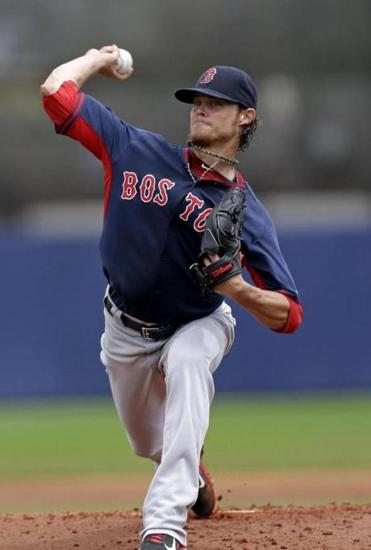 Clay Buchholz stayed behind while the rest of the team flew to Baltimore after Saturday's Grapefruit League finale.
