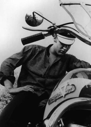 Elvis Presley posed on a motorcycle in Memphis in 1956.
