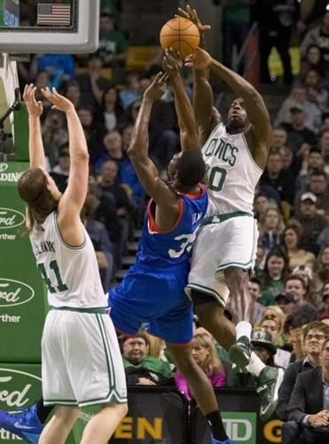 Brandon Bass put defensive pressure on Henry Sims in the second period.