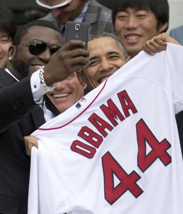 Red Sox designated hitter David Ortiz snaps the now-infamous selfie with President Obama at the White House.