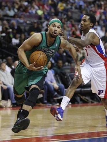 Celtics guard Jerryd Bayless (drives)  to the basket against the Pistons on Saturday night. Duane Burleson/associated press