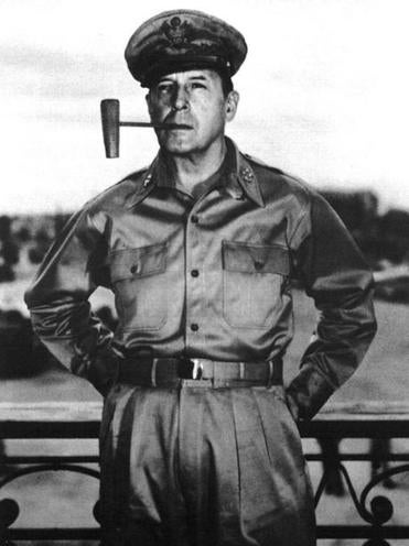 General Douglas MacArthur with his trademark corncob pipe.