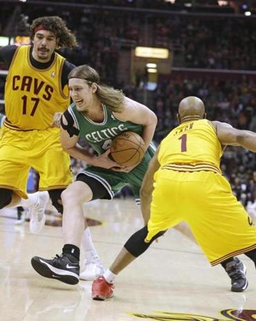 The Celtics' Kelly Olynyk (pictured) and Avery Bradley each scored 25 points in Saturday's 111-99 victory over the Cavaliers.
