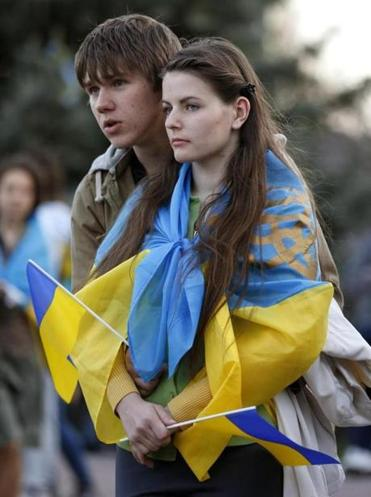 A couple attended a pro-Ukrainian rally in Luhansk. An accord signed in Geneva called for militants to disarm.