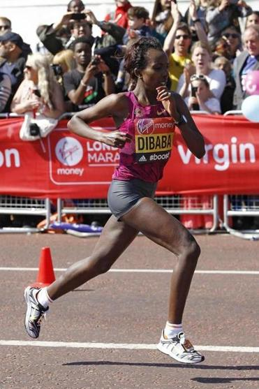 Tirunesh Dibaba of Ethiopia passes Buckingham Palace during the Virgin London Marathon April 13.