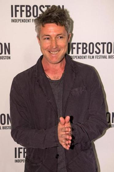 "Actor Aidan Gillen, reluctantly posed for photos before a showing of the film ""Beneath the Harvest Sky"" during opening night of the Independent Film Festival Boston."