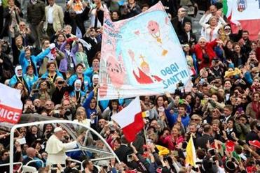 "Pope Francis greeted a joyous crowd after canonizing John Paul II and John XXIII, whom he called ""men of courage."""