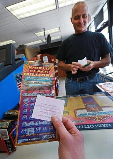 Greg Zarzour visited Ted's Stateline Mobil in Methuen on Monday, where a clerk held out one of the state's new $30 lottery tickets.