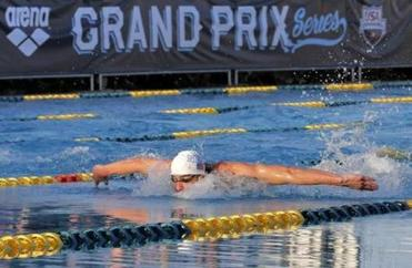 Michael Phelps finished second in the 100-meter butterfly final during the Arena Grand Prix swim event in Mesa, Ariz.