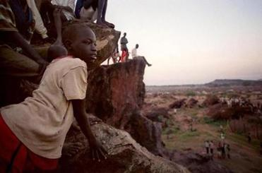 Refugees in the Kakuma camp in Kenya watch distribution of food in 2001, when Sudan also faced drought and starvation.