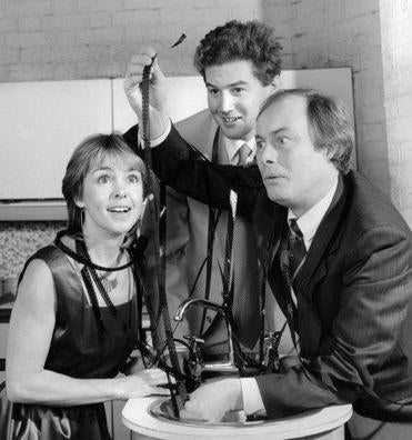 "Wendy Padbury, Timothy Ackroyd, and Ian Masters in a 1987 production of ""No Sex Please, We're British."""