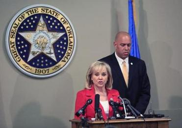 Governor Mary Fallin has stayed a scheduled  execution as prison officials look into  Clayton Lockett's botched lethal injection.