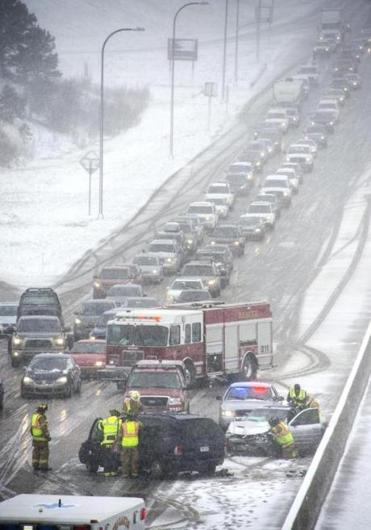 Heavy snowfall led to a series of accidents and partial closures of Interstate 25 Sunday near Colorado Springs. More than a foot of snow was expected in some parts of the state.