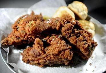 Fried chicken served with biscuits and slaw.