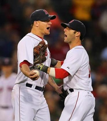 Dustin Pedroia (right) does his best to calm down Jake Peavy after he was called for a balk in the fourth inning.