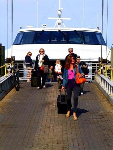Passengers leave the  Seastreak ferry that brought them from New Bedford to Oak Bluffs in an hour.