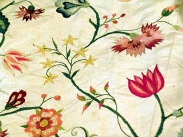 Colonial era fashionista Elizabeth Bull already knew this when she envisioned the design of her own colorfully hand-embroidered silk wedding gown. A close image of the embroidery. (Handout)