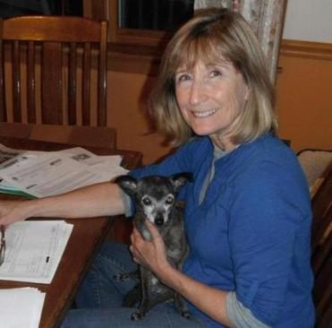 Linda Murphy, here with her dog Lola, says local pet stores sell dogs that are bred at puppy mills under awful conditions.