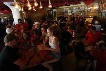 Boston, Massachusetts -- 06/30/2014-- Tables are full at Loretta's Last Call near Fenway Park in Boston, Massachusetts June 30, 2014. Jessica Rinaldi/Globe Staff Topic: 06quickbitepic Reporter: