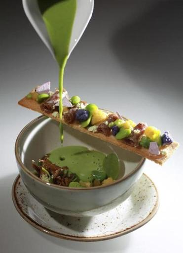 Dishes offered at Liquid Art House include sweet pea veloute.