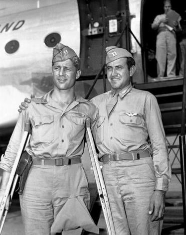 "Captain Louis Zamperini (right) with another prisoner of war, Fred Garrett, after they returned to California in 1945. Mr. Zamperini was known as the ""Torrance Tornado."""