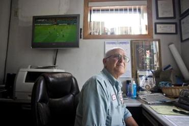 J & K Auto Body owner John Sarianides pledged to make Dan Shaughnessy love the Beautiful Game.