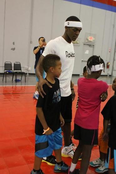 Rajon Rondo hosted his annual youth basketball camp this week while the Celtics were busy working their free agency priorities.
