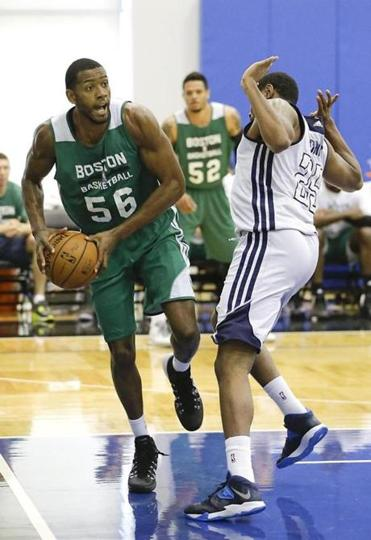 The Celtics' Mike Moser looks to pass around Indiana's Kevin Jones during Friday's game.