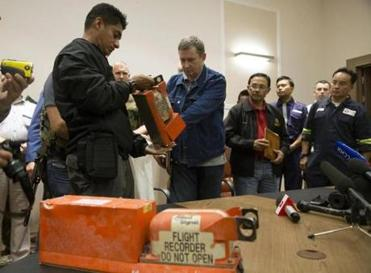 A Malaysian investigator took a black box from a Donetsk official.